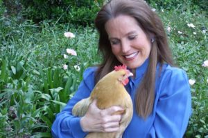 Charlotte Laws and one of her hens
